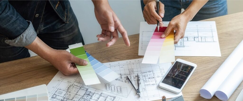 Two contractors picking paint colors for a home remodel.