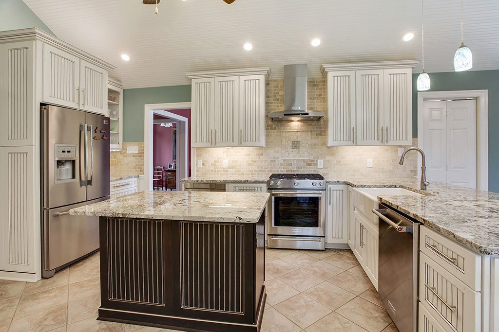 An image of a newly renovated kitchen with a large square island.