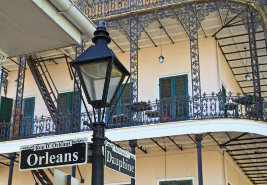 mlm incorporated orleans dauphine street building balcony wrough iron lamp post