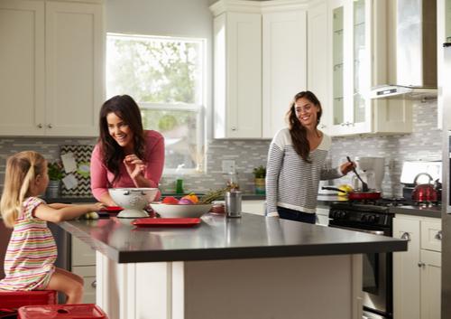 women and child using kitchen island