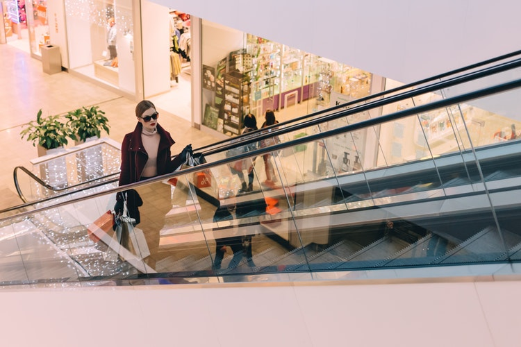 People on escalators in a mall